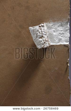 tearing plasterboard