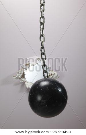 metal ball cracking down a wall