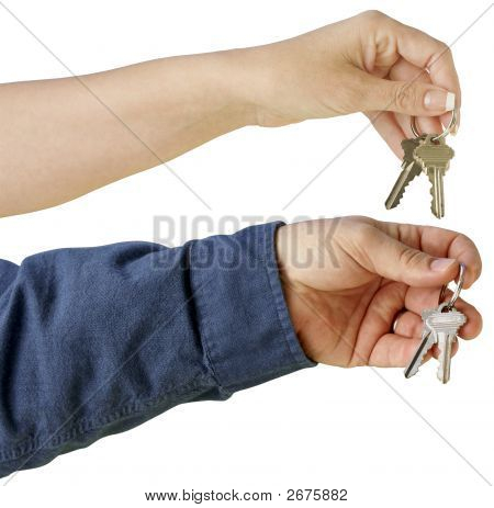 Man And Woman Handing Over House Keys