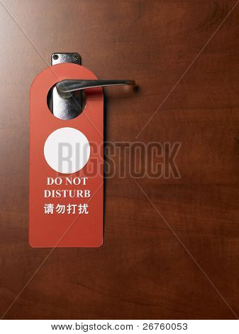 sign on the door handle do not disturb