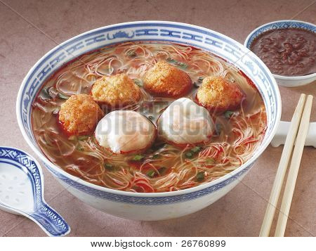 A bowl of curry noodles.