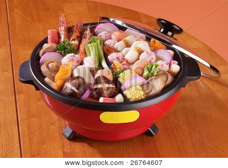 An electric slow cooker on a table