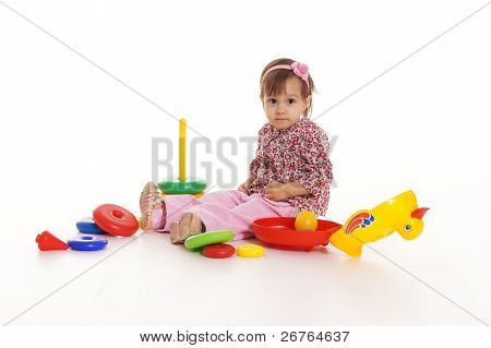 Little Girl With Toys