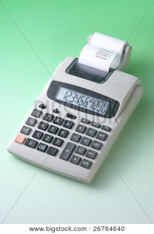 Calculator and receipts on green background