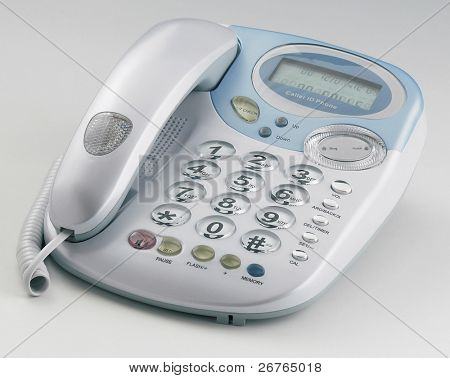 Modern Caller ID Phone With Receiver down on a plain background