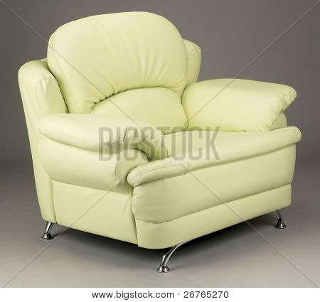 Single seater couch on plain background