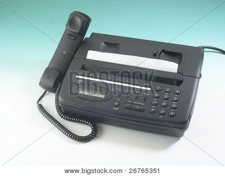 Fax machine isolated on clean background with the receiver off the hook.