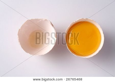 stock image of the cracked egg with yolk