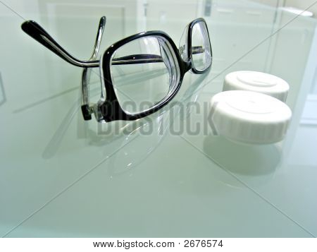 Close Up Shot Of Eyeglasses And Contact Lens Case