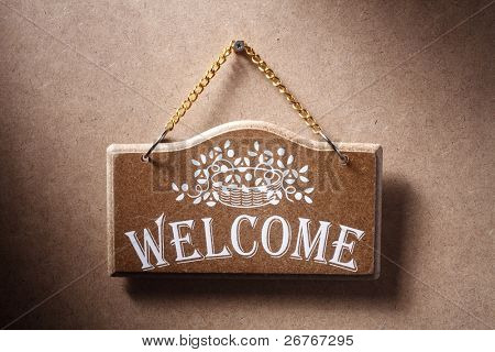 Welcome sign hung on background.