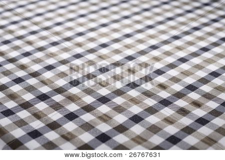 Stock image of brown and black checkered cloth.