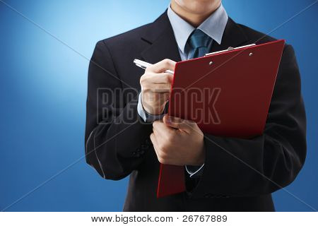 stock image of the man filling of form