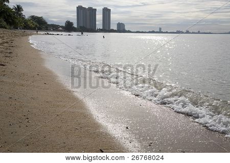 Sea landscape - sea, golden beach, the blue sky and white clouds.