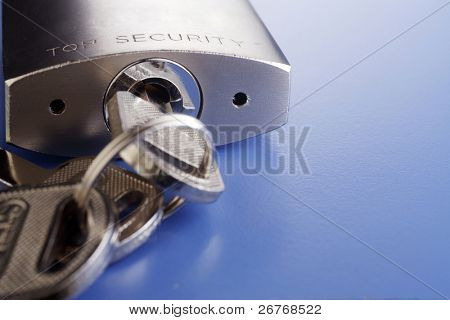Padlock with key isolated on background.