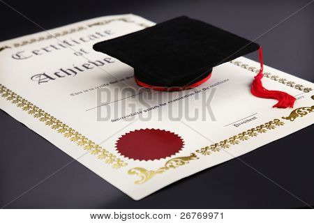 mini mortar board on the blank certificate