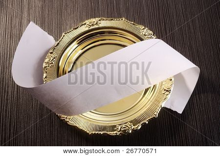 rolled up paper on the golden plate