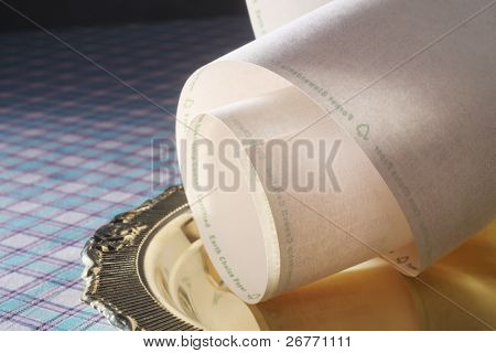 paper roll with printout on the tray