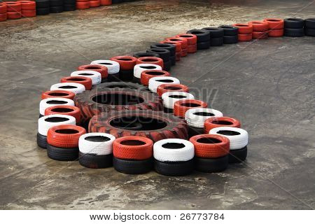 Safety barriers made of old wheels in indoor carting hall