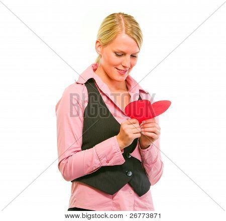 Happy Female Business Secretary Reading Valentine Paper Heart
