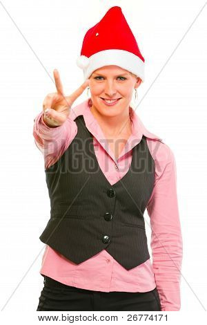 Happy Female Business Clerk In Santa Hat Showing Victory Gesture