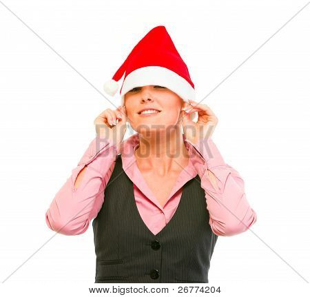 Smiling Female Business Secretary Pulling Santa Hat On Eyes