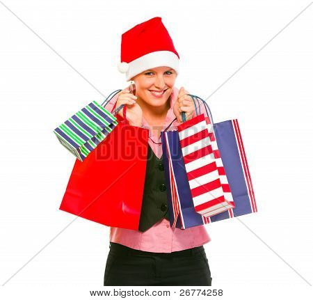 Happy Female Business Secretary In Santa Hat With Shopping Bags