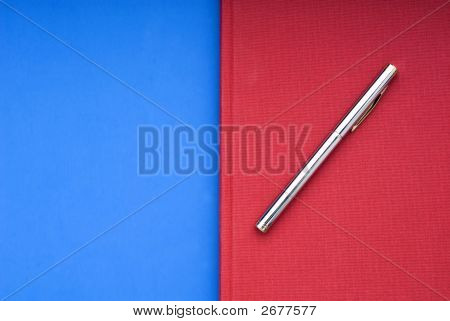Red Book On A Blue Background