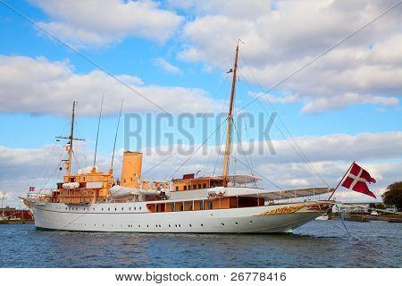"""COPENHAGEN - AUGUST 25: The Danish Queen's Naval Yacht """"Dannebrog"""" expecting arrival of the Queen in Copenhagen harbor on August 25, 2010 in Copenhagen."""