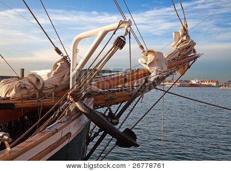 Vintage 19th-century sailing ship mast, anchor and sails