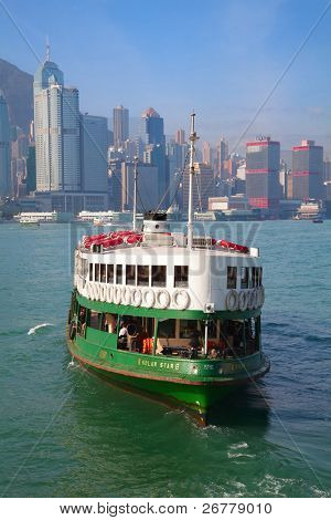 """HONG KONG - DECEMBER 3: Ferry """"Solar star"""" leaving Kowloon pier on December 3, 2010 in Hong Kong, China. Ferry is in operation for over 120 years and is one main tourist attractions of the city."""