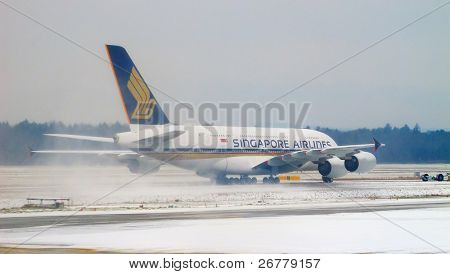 ZURICH - DECEMBER 15: Singapore Airlines A-380 taking off after deicing on December 15, 2010 in Zurich, Switzerland. The deicing applied by major european airport due to cold and snowy conditions