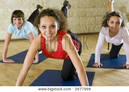 Women Exercising On Mat