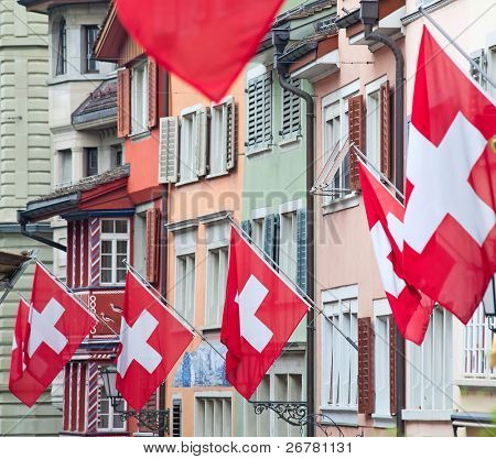 Ancient street Augustinergasse in Zurich decorated with swiss flags