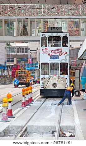 HONG KONG - DECEMBER 05: Repair work on city tram line in Hong Kong on December 05, 2010. Tram is the only system in the world run with double deckers and one of the main tourist attractions.