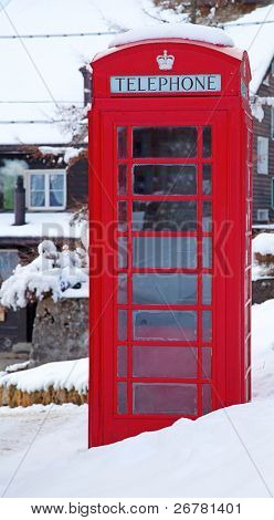 Famous London red telephone booth in snow