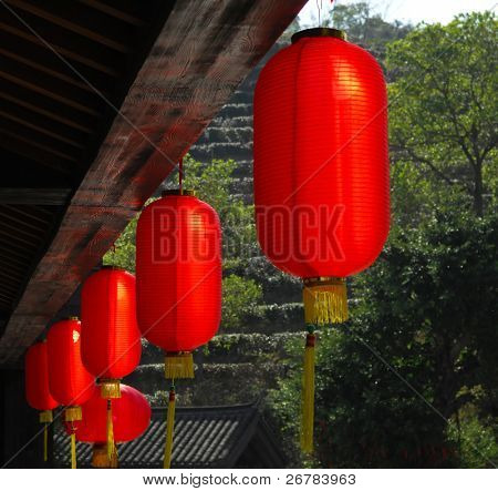 red lanterns with chinese letters printed. It brings good luck and peace to prayer. It was at night in a chinese temple during Chinese New Year.