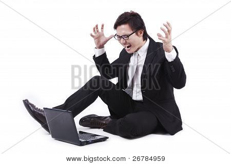 Businessman Yells To His Laptop
