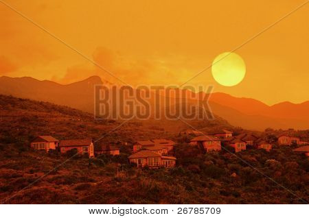 House on a hillside, beautiful brand new home in a rural setting with sunset
