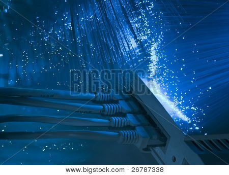 network cable and hub closeup with fiber optical background