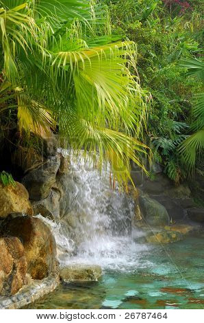 waterfall in to a pool in a luxury hotspring