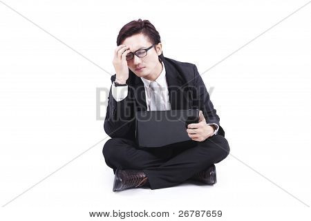 Sick Businessman Sits On Floor With His Laptop
