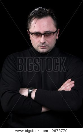Portrait Of The Man On A Black Background