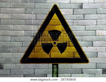 nuclear symbol on abstract rough grunge brick wall background