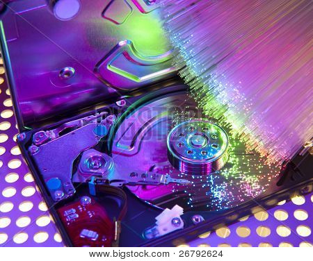 harddisk and heads on technology fiber optics background