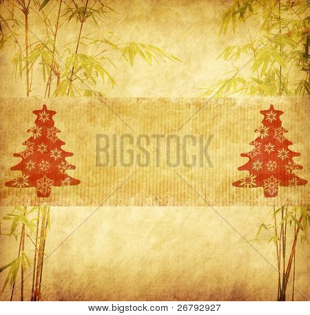 Christmas tree and bamboo trees with texture of handmade paper
