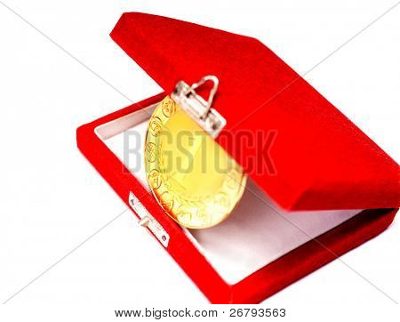 detail shot of a gold medal in a box