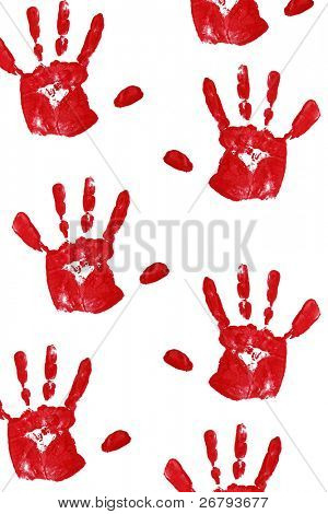 close up red child handprints on white