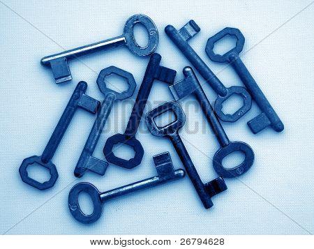 close up shot of several keys on white background