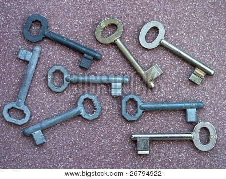 close up shot of several keys on brown background