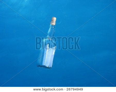 close up shot of a bottle on the water